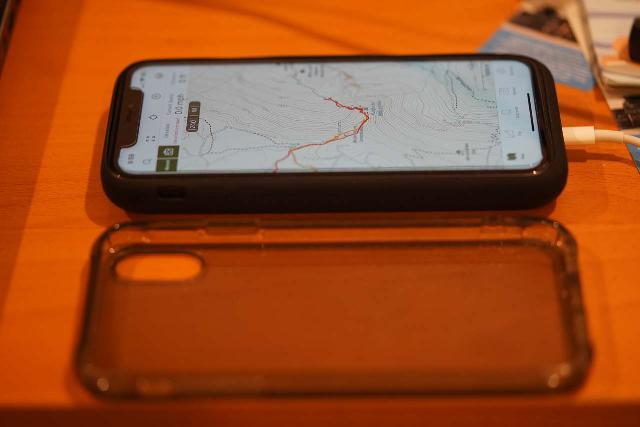 The iPhone connected to a battery pack to extend its usage before running out of charge. This is a very important backcountry usage consideration